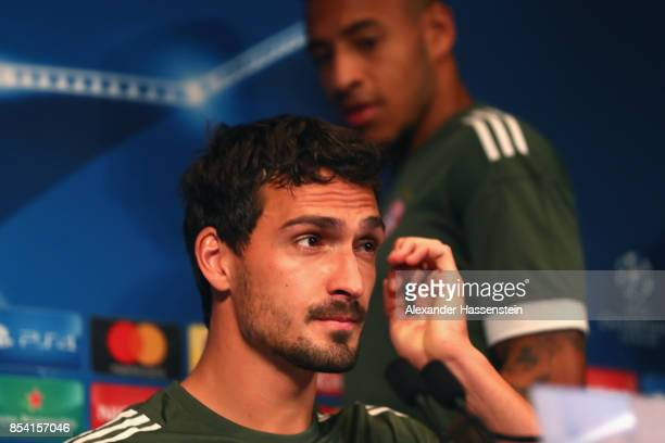 Mats Hummels of Bayern Muenchen and his team mate Corentin Tolisso arrive for a press conference ahead of the UEFA Champions League Group B match...