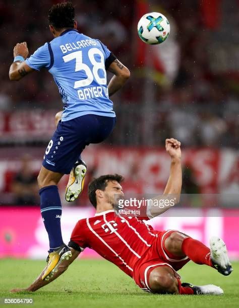 Mats Hummels of Bayern Muenchen and Karim Bellarabi of Leverkusen battle for the ball during the Bundesliga match between FC Bayern Muenchen and...