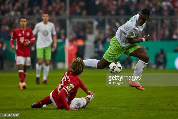Mats Hummels of Bayern Muenchen and Riechedly Bazoer of VfL Wolfsburg battle for the ball during the DFB Cup RoandOf 16 match between Bayern Muenchen...