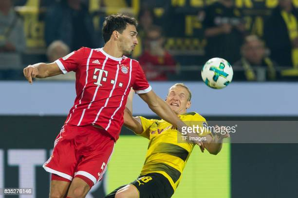 Mats Hummels of Bayern Muenchen and Sebastian Rode of Dortmund battle for the ball during the DFL Supercup 2017 match between Borussia Dortmund and...