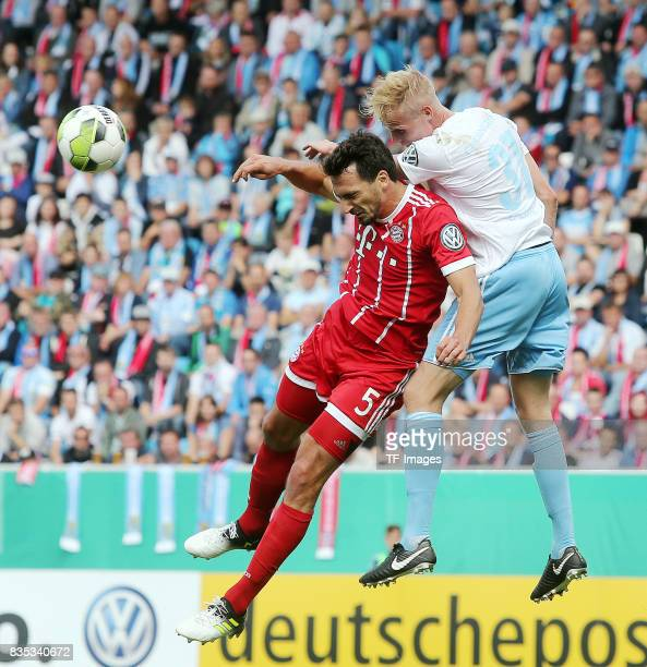 Mats Hummels of Bayern Muenchen and Tom Scheffel of Chemnitz battle for the ball during the DFB Cup first round match between Chemnitzer FC and FC...
