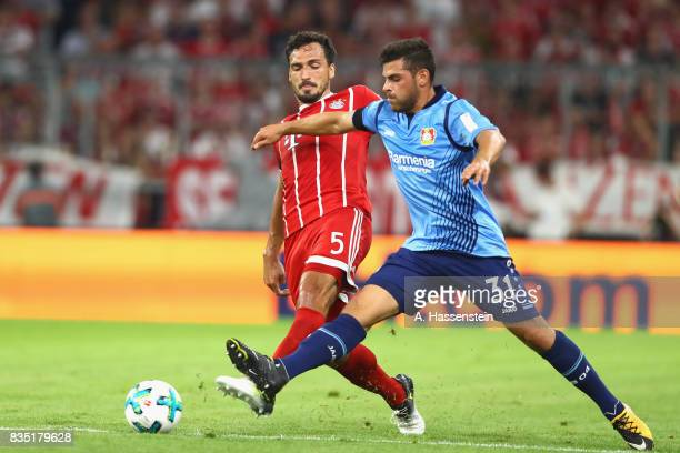 Mats Hummels of Bayern Muenchen battles for the ball with Kevin Volland of Leverkusen during the Bundesliga match between FC Bayern Muenchen and...