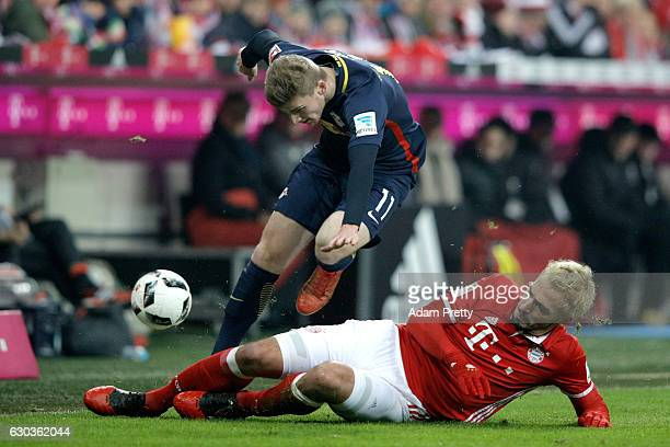 Mats Hummels of Bayern Muenchen tackles Timo Werner of RB Leipzig during the Bundesliga match between Bayern Muenchen and RB Leipzig at Allianz Arena...