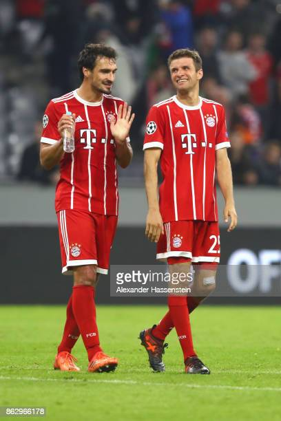 Mats Hummels of Bayern Muenchen talks to his team mate Thomas Mueller after the UEFA Champions League group B match between Bayern Muenchen and...