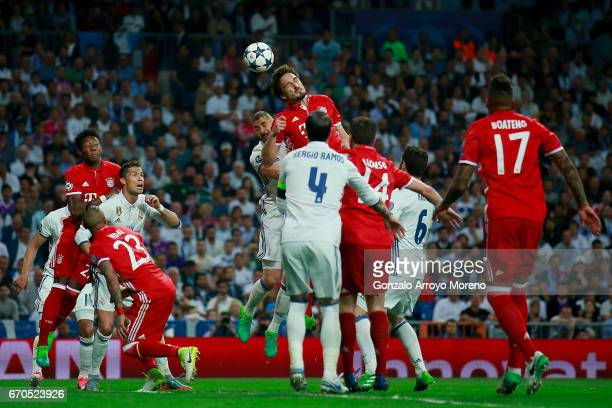 Mats Hummels of Bayern Muenchen wins the header after Karim Benzema of Real Madrid CF during the UEFA Champions League Quarter Final second leg match...