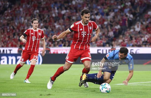 Mats Hummels of Bayern Muenchen with Kevin Volland of Bayer Leverkusen while Sebastian Rudy of Bayern Muenchen looks on during the Bundesliga match...