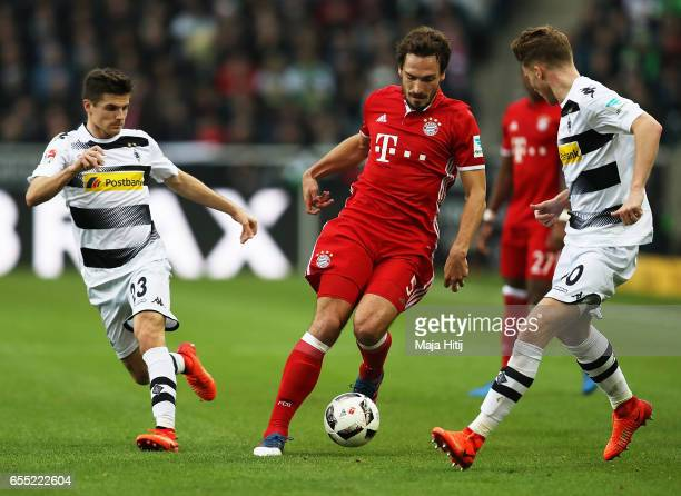 Mats Hummels of Bayern Munich is challenged by Jonas Hofmann of Borussia Moenchengladbach during the Bundesliga match between Borussia...