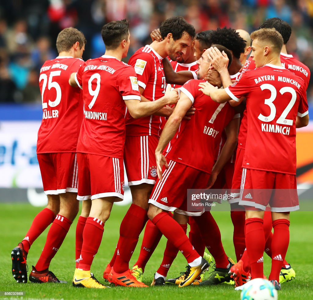Mats Hummels of Bayern Munich is congratulated after socring a goal during the Bundesliga match between Hertha BSC and FC Bayern Muenchen at Olympiastadion on October 1, 2017 in Berlin, Germany.