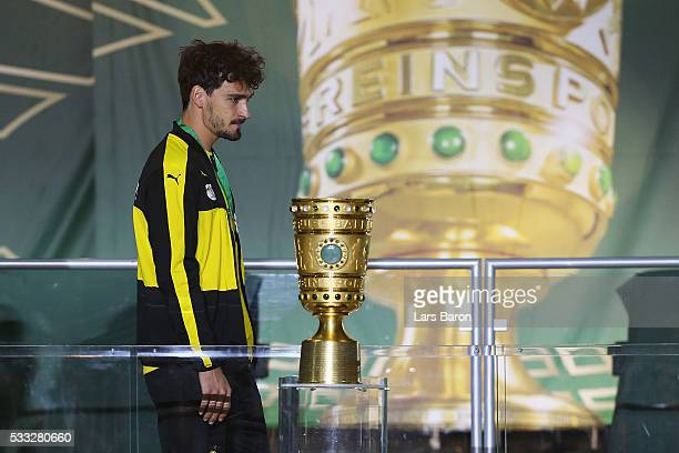 Mats Hummels of Borussia Dortmund looks dejected after receiving his medal and loosing the DFB Cup Final against Bayern Muenchen at Olympiastadion on...