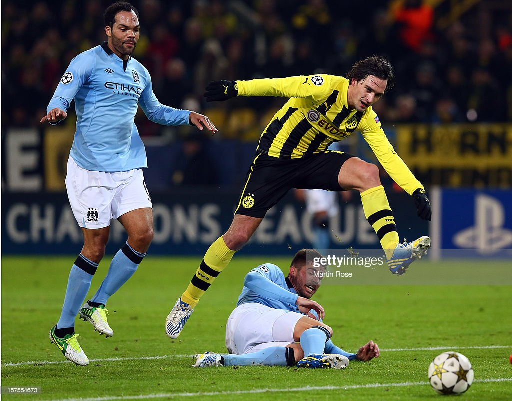 <a gi-track='captionPersonalityLinkClicked' href=/galleries/search?phrase=Mats+Hummels&family=editorial&specificpeople=595395 ng-click='$event.stopPropagation()'>Mats Hummels</a> (R) of Dortmund and Javi Garcia (L) of Manchester battle for the ball during the UEFA Champions League group D match between Borussia Dortmund and Manchester City at Signal Iduna Park on December 4, 2012 in Dortmund, Germany.