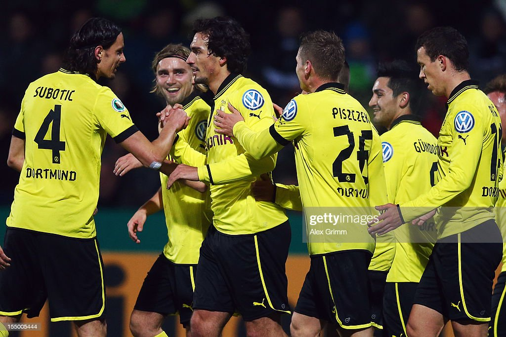 Mats Hummels of Dortmund celebrates his team's first goal with team mates during the second round match of the DFB Cup between VfR Aalen and Borussia...
