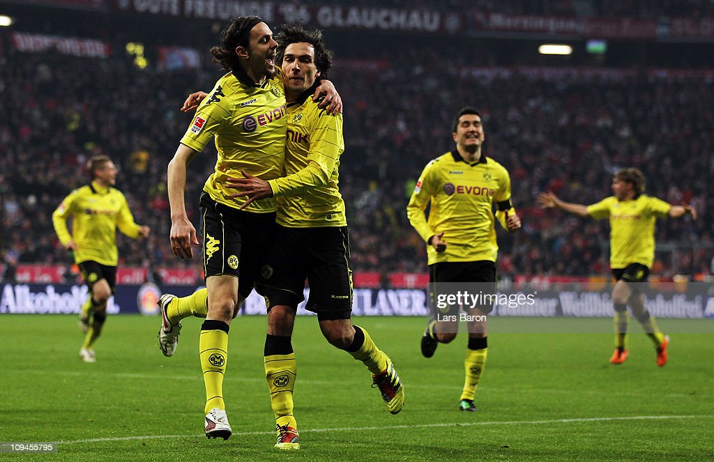 <a gi-track='captionPersonalityLinkClicked' href=/galleries/search?phrase=Mats+Hummels&family=editorial&specificpeople=595395 ng-click='$event.stopPropagation()'>Mats Hummels</a> of Dortmund celebrates with <a gi-track='captionPersonalityLinkClicked' href=/galleries/search?phrase=Neven+Subotic&family=editorial&specificpeople=2234315 ng-click='$event.stopPropagation()'>Neven Subotic</a> after scoring his teams third goal during the Bundesliga match between FC Bayern Muenchen and Borussia Dortmund at Allianz Arena on February 26, 2011 in Munich, Germany.