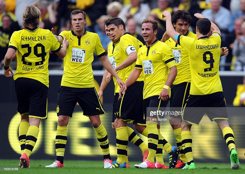 <a gi-track='captionPersonalityLinkClicked' href=/galleries/search?phrase=Mats+Hummels&family=editorial&specificpeople=595395 ng-click='$event.stopPropagation()'>Mats Hummels</a> of Dortmund celebrates with Robert Lewandowski and other team mates after scoring his teams first goal during the Bundesliga match between Borussia Dortmund and Bayer 04 Leverkusen at Signal Iduna Park on September 15, 2012 in Dortmund, Germany.