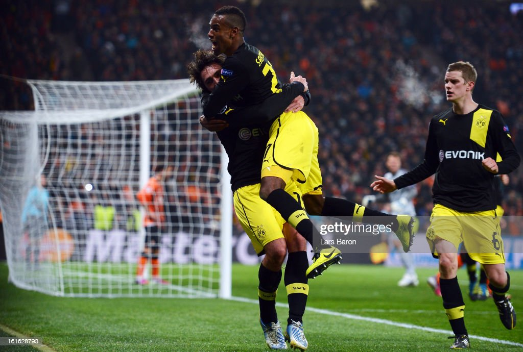 Mats Hummels of Dortmund celebrates with team mates Felipe Santana and Sven Bender after scoring his teams second goal during the UEFA Champions League Round of 16 first leg match between Shakhtar Donetsk and Borussia Dortmund at Donbass Arena on February 13, 2013 in Donetsk, Ukraine.