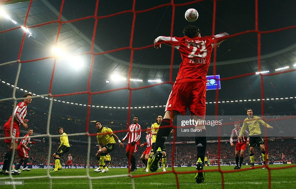 <a gi-track='captionPersonalityLinkClicked' href=/galleries/search?phrase=Mats+Hummels&family=editorial&specificpeople=595395 ng-click='$event.stopPropagation()'>Mats Hummels</a> of Dortmund heads his teams third goal over <a gi-track='captionPersonalityLinkClicked' href=/galleries/search?phrase=Danijel+Pranjic&family=editorial&specificpeople=698546 ng-click='$event.stopPropagation()'>Danijel Pranjic</a> of Muenchen during the Bundesliga match between FC Bayern Muenchen and Borussia Dortmund at Allianz Arena on February 26, 2011 in Munich, Germany.