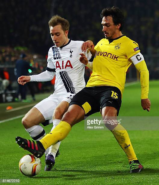 Mats Hummels of Dortmund is challenged by Christian Eriksen of Tottenham during the UEFA Europa League Round of 16 first leg match between Borussia...