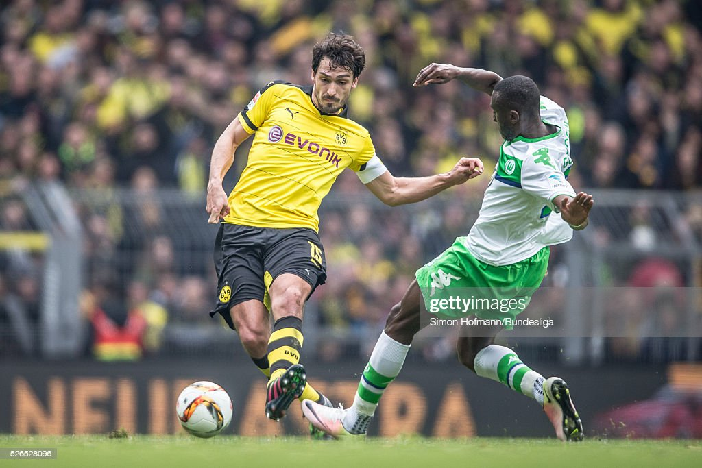 Mats Hummels of Dortmund is challenged by Naldo of Wolfsburg during the Bundesliga match between Borussia Dortmund and VfL Wolfsburg at Signal Iduna Park on April 30, 2016 in Dortmund, North Rhine-Westphalia.