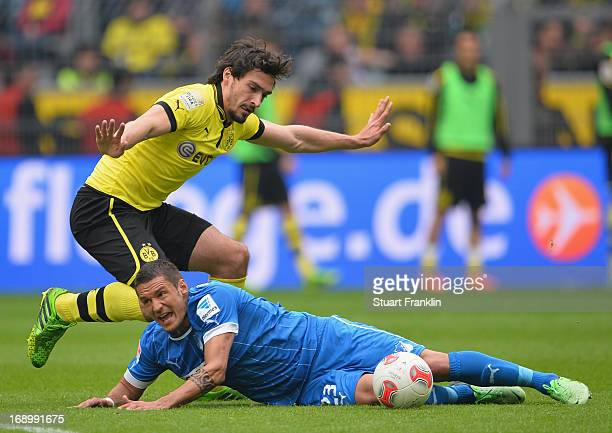 Mats Hummels of Dortmund is challenged by Sejad Salihovic of Hoffenheim during the Bundesliga match between Borussia Dortmund and TSG 1899 Hoffenheim...