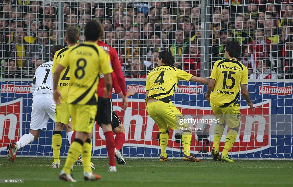 <a gi-track='captionPersonalityLinkClicked' href=/galleries/search?phrase=Mats+Hummels&family=editorial&specificpeople=595395 ng-click='$event.stopPropagation()'>Mats Hummels</a> (R) of Dortmund reacts after scoring an own goal during the Bundesliga match between SC Freiburg and Borussia Dortmund at the Badenova Stadium on November 20, 2010 in Freiburg im Breisgau, Germany.