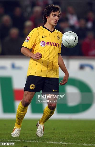 Mats Hummels of Dortmund runs with the ball during the Bundesliga match between 1 FC Koeln and Borussia Dortmund at the RheinEnergie stadium on...