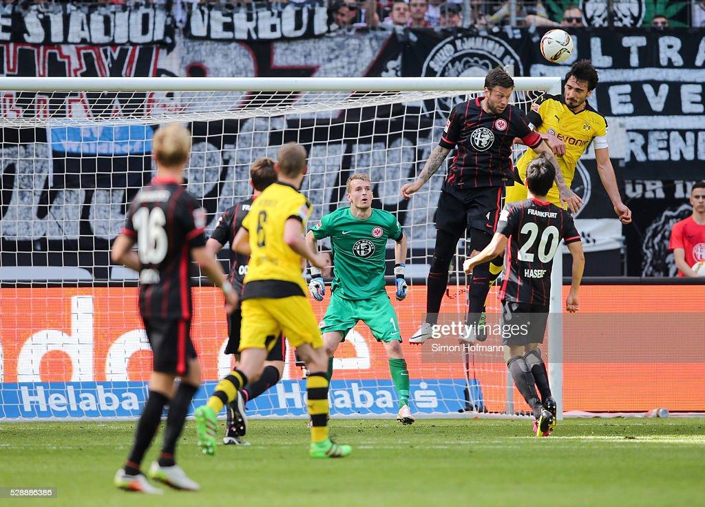 Mats Hummels of Dortmund scores a disallowed goal with a header against Marco Russ of Frankfurt during the Bundesliga match between Eintracht...