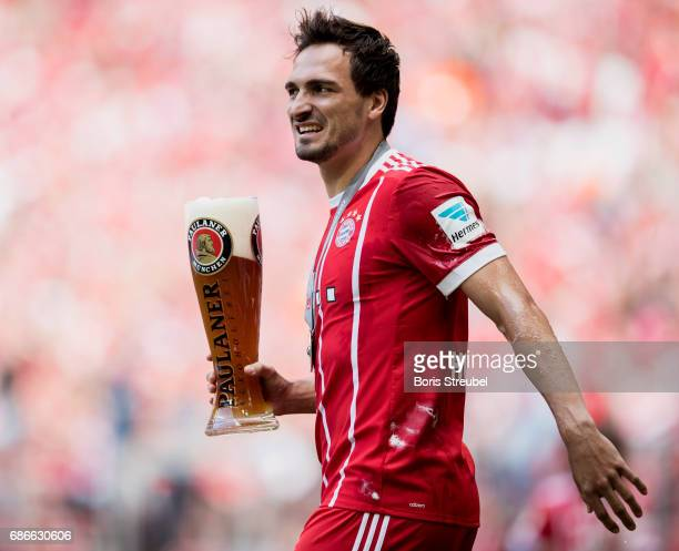 Mats Hummels of FC Bayern Muenchen celebrates after the presentation of the 67th German Championship title following the Bundesliga match between...