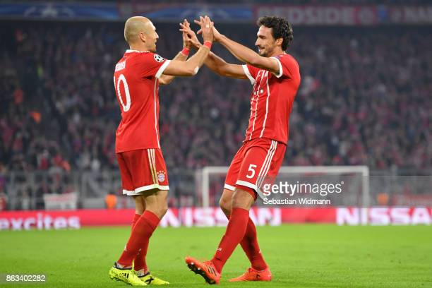 Mats Hummels of FC Bayern Muenchen celebrates scoring his teams third goal with teammate Arjen Robben during the UEFA Champions League group B match...
