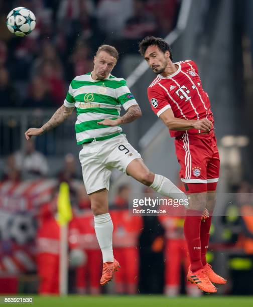 Mats Hummels of FC Bayern Muenchen jumps for a header with Leigh Griffiths of Celtic FC during the UEFA Champions League group B match between Bayern...