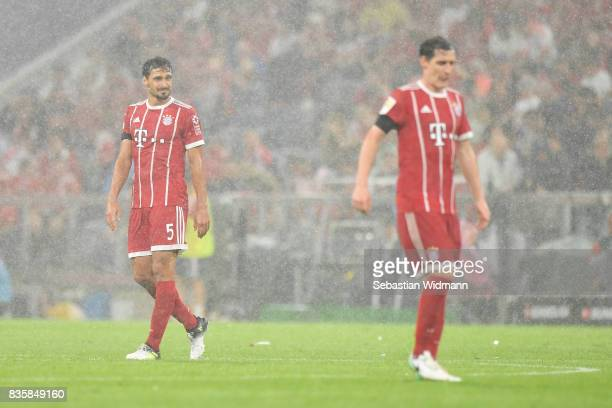 Mats Hummels of FC Bayern Muenchen looks on during a heavy rain shower during the Bundesliga match between FC Bayern Muenchen and Bayer 04 Leverkusen...