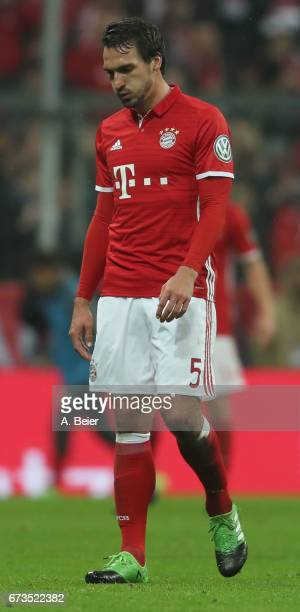 Mats Hummels of FC Bayern Muenchen reacts as he is exchanged during the DFB Cup semi final match between FC Bayern Muenchen and Borussia Dortmund at...