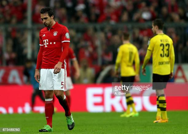 Mats Hummels of FC Bayern Muenchen reacts during the DFB Cup semi final match between FC Bayern Muenchen and Borussia Dortmund at Allianz Arena on...