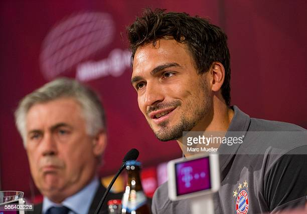 Mats Hummels of FC Bayern Munich and Carlo Ancelotti headoach of FC Bayern Munich attend a press conference at Allianz Arena on August 6 2016 in...