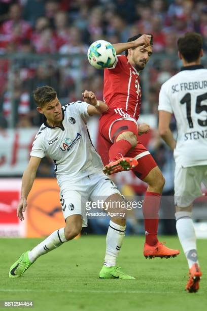 Mats Hummels of FC Bayern Munich in action against Florian Niederlechner SC Freiburg during the Bundesliga soccer match between FC Bayern Munich and...