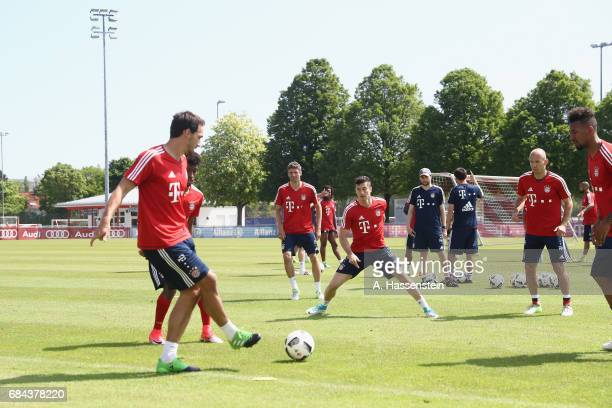 Mats Hummels of FC Bayern plays the ball during a training session at Saebener Strasse training ground on May 18 2017 in Munich Germany