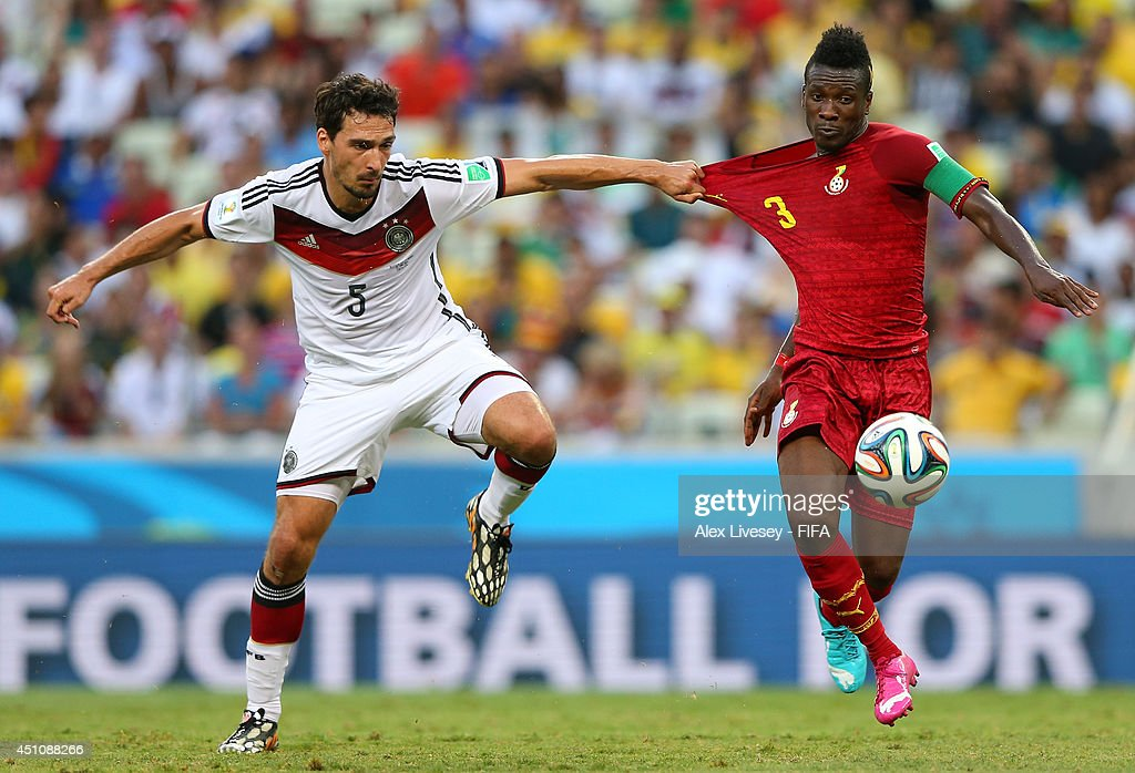 <a gi-track='captionPersonalityLinkClicked' href=/galleries/search?phrase=Mats+Hummels&family=editorial&specificpeople=595395 ng-click='$event.stopPropagation()'>Mats Hummels</a> of Germany and <a gi-track='captionPersonalityLinkClicked' href=/galleries/search?phrase=Asamoah+Gyan&family=editorial&specificpeople=535782 ng-click='$event.stopPropagation()'>Asamoah Gyan</a> of Ghana compete for the ball during the 2014 FIFA World Cup Brazil Group G match between Germany and Ghana at Castelao on June 21, 2014 in Fortaleza, Brazil.
