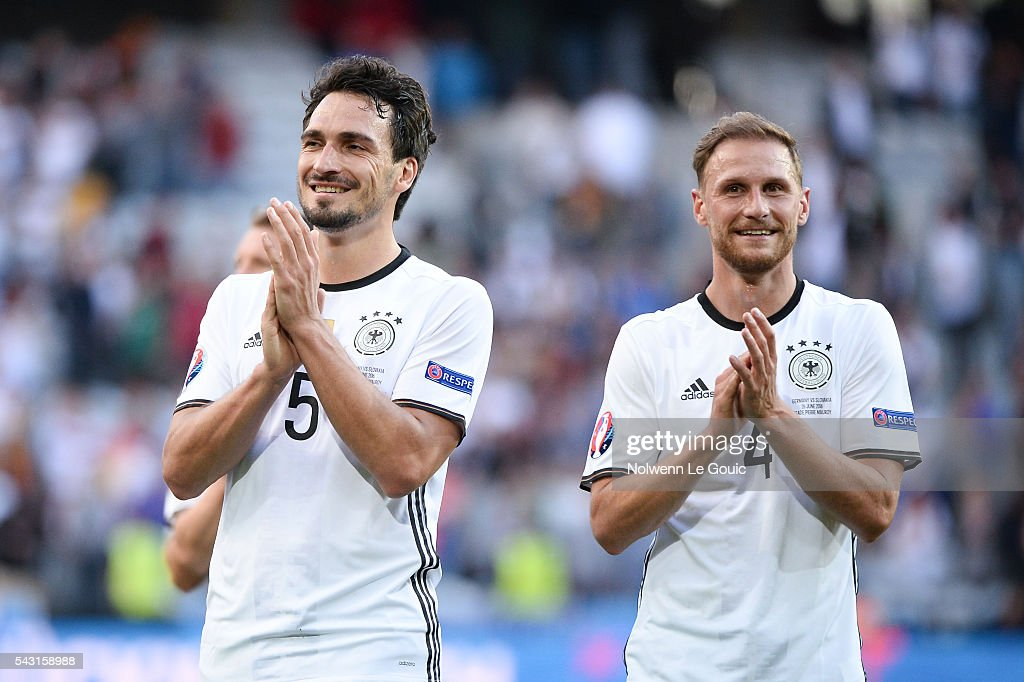 Mats Hummels of Germany and Benedikt Howedes of Germany celebrate victory during the European Championship match Round of 16 between Germany and Slovakia at Stade Pierre-Mauroy on June 26, 2016 in Lille, France.
