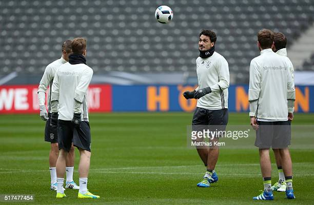Mats Hummels of Germany and his team mates warm up during a Germany training session ahead of a international friendly match against England at...