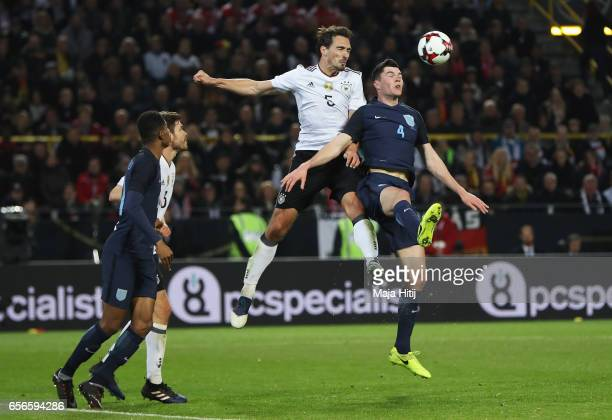 Mats Hummels of Germany and Michael Keane of England clash during the international friendly match between Germany and England at Signal Iduna Park...