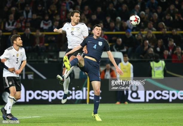 Mats Hummels of Germany and Michael Keane of England in action during the international friendly match between Germany and England at Signal Iduna...