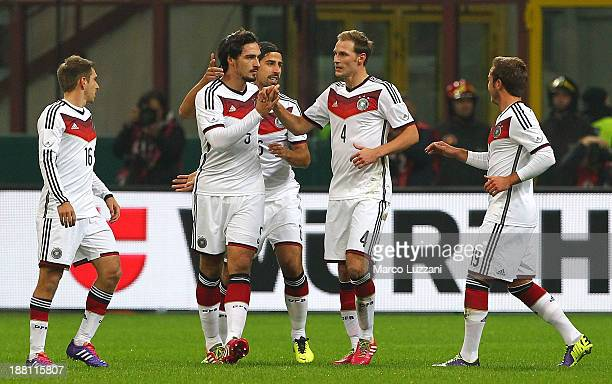 Mats Hummels of Germany celebrates with his teammates Sami Khedira and Benedikt Howedes after scoring the opening goal during the international...