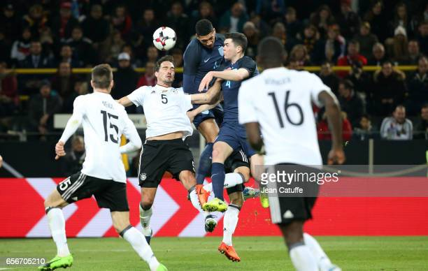 Mats Hummels of Germany Chris Smalling and Michael Keane of England in action during the international friendly match between Germany and England at...