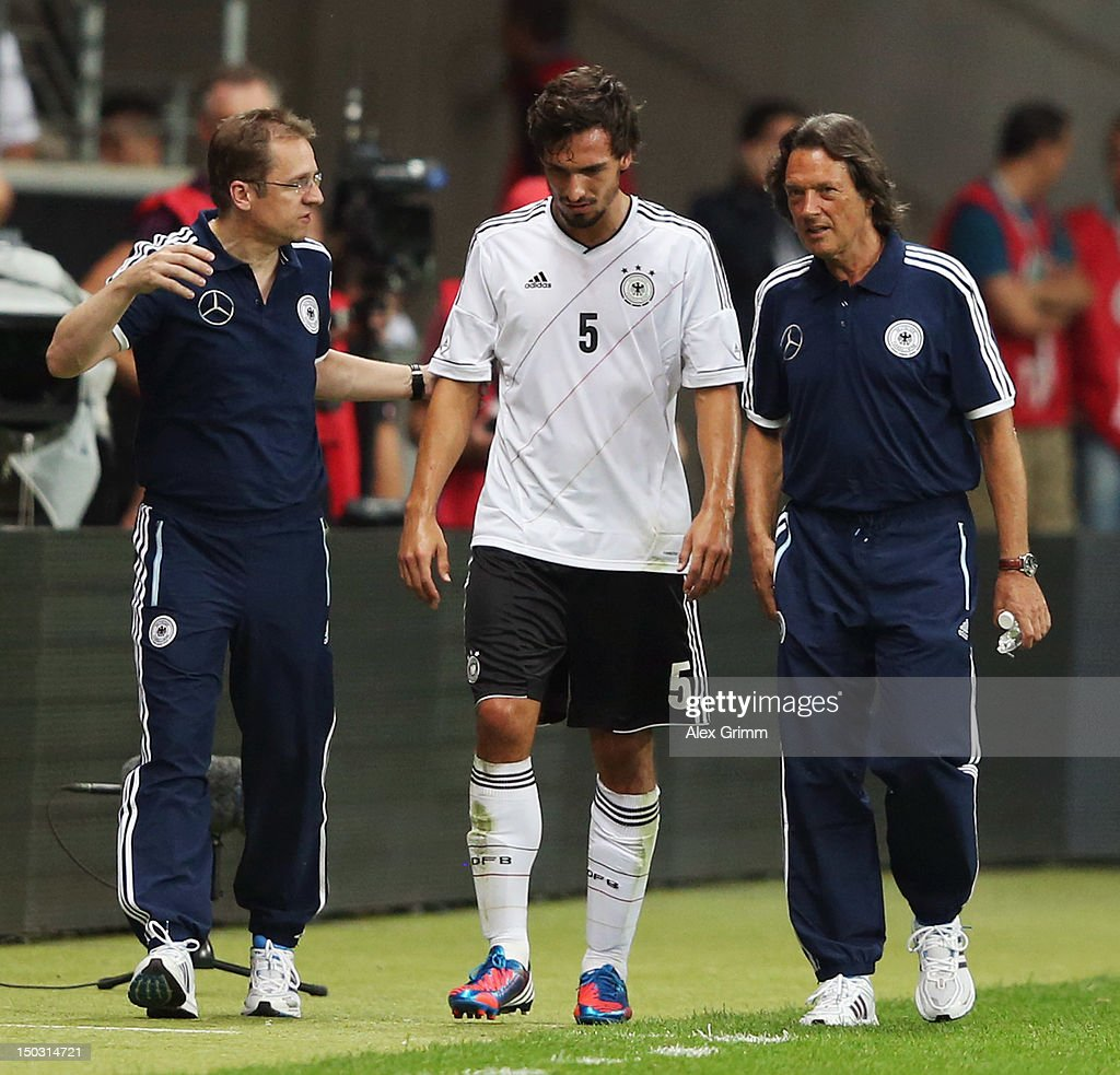 <a gi-track='captionPersonalityLinkClicked' href=/galleries/search?phrase=Mats+Hummels&family=editorial&specificpeople=595395 ng-click='$event.stopPropagation()'>Mats Hummels</a> of Germany is led off the pitch by team doctors <a gi-track='captionPersonalityLinkClicked' href=/galleries/search?phrase=Tim+Meyer&family=editorial&specificpeople=623213 ng-click='$event.stopPropagation()'>Tim Meyer</a> (L) and Hans-Wilhelm Mueller-Wohlfahrt during the international friendly match between Germany and Argentina at Commerzbank-Arena on August 15, 2012 in Frankfurt am Main, Germany.