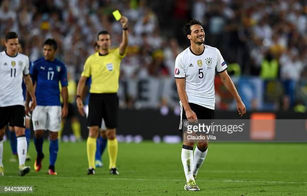 Mats Hummels of Germany is shown a yellow card by referee Viktor Kassai during the UEFA EURO 2016 quarter final match between Germany and Italy at...