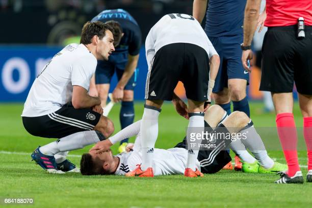 Mats Hummels of Germany Julian Weigl of Germany am boden und Joshua Kimmich of Germany gestures during the international friendly match between...