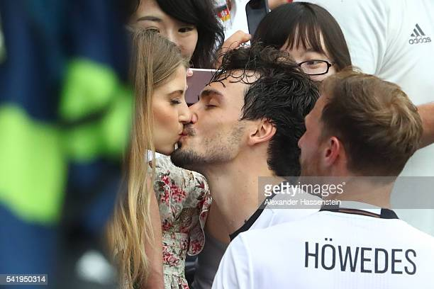 Mats Hummels of Germany kisses his wife Cathy Hummels after his team's 10 win in the UEFA EURO 2016 Group C match between Northern Ireland and...