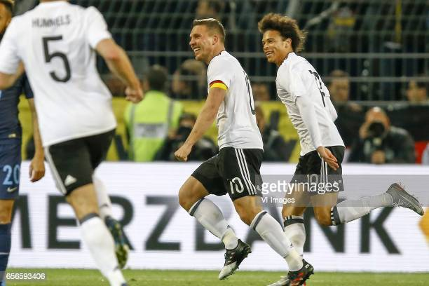 Mats Hummels of Germany Lukas Podolski of Germany scored Leroy Sane of Germanyduring the friendly match between Germany and England on March 22 2017...