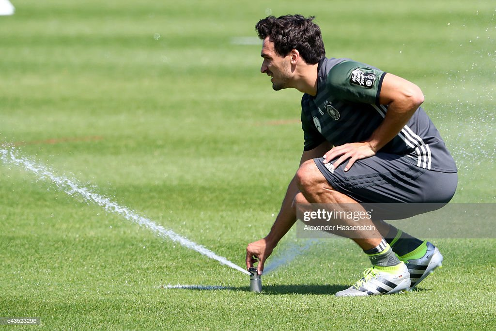 <a gi-track='captionPersonalityLinkClicked' href=/galleries/search?phrase=Mats+Hummels&family=editorial&specificpeople=595395 ng-click='$event.stopPropagation()'>Mats Hummels</a> of Germany plays with the automatic water sprinkler on the field during a Germany training session at Ermitage Evian on June 29, 2016 in Evian-les-Bains, France.