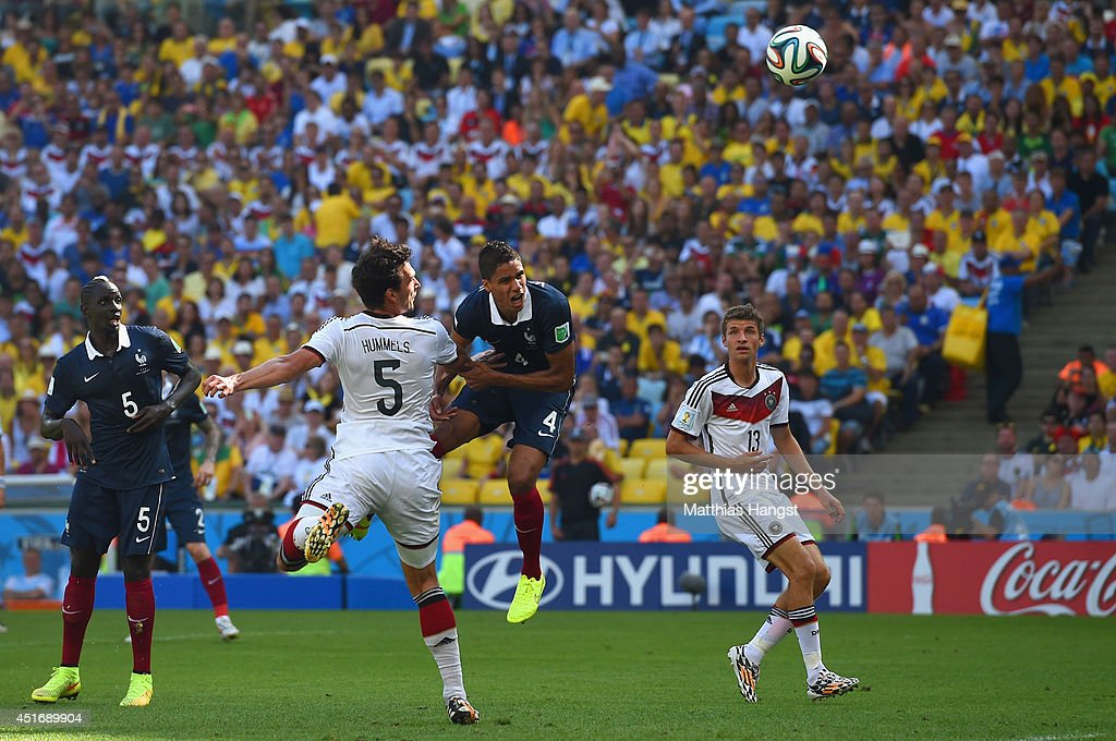 Mats Hummels of Germany scores his team's first goal against Raphael Varane of France during the 2014 FIFA World Cup Brazil Quarter Final match between France and Germany at Maracana on July 4, 2014 in Rio de Janeiro, Brazil.
