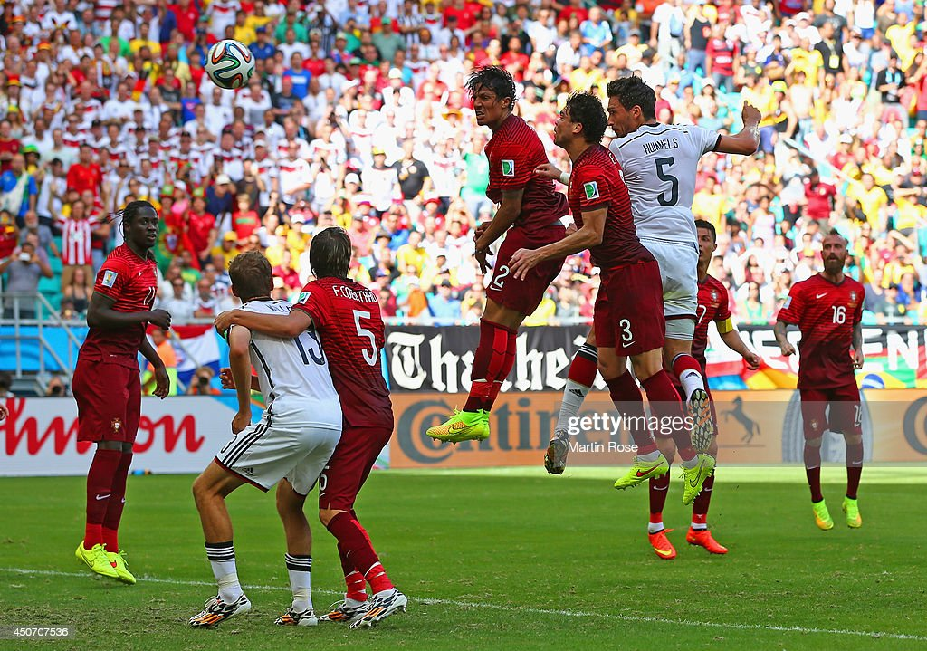 <a gi-track='captionPersonalityLinkClicked' href=/galleries/search?phrase=Mats+Hummels&family=editorial&specificpeople=595395 ng-click='$event.stopPropagation()'>Mats Hummels</a> of Germany scores on a header for his team's second goal against <a gi-track='captionPersonalityLinkClicked' href=/galleries/search?phrase=Bruno+Alves&family=editorial&specificpeople=2149132 ng-click='$event.stopPropagation()'>Bruno Alves</a> and Pepe of Portugal during the 2014 FIFA World Cup Brazil Group G match between Germany and Portugal at Arena Fonte Nova on June 16, 2014 in Salvador, Brazil.