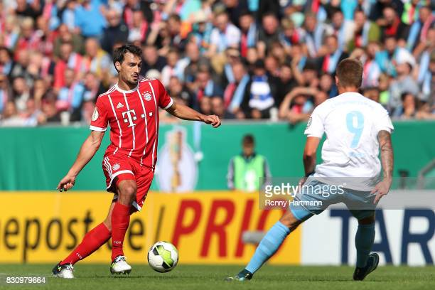 Mats Hummels of Muenchen and Florian Trinks of Chemnitz vie during the DFB Cup first round match between Chemnitzer FC and FC Bayern Muenchen at...
